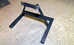 This engine stand is a great candidate for powder coating, but to fit it into the curing oven without smudging, I have to invent some standoffs and supports.