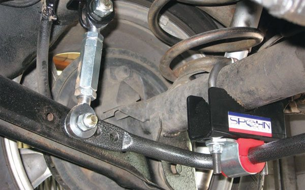 This link-mounted bar takes up no more space than the original bar, and adds hardly any weight, but is very mechanically efficient. It generates many times the effective rate, allowing perfect balancing without adding excessive weight or binding up the lower trailing arms in torsion. This is an SC&C-designed GM G-body adjustable-rate rear bar, built by Spohn Performance.