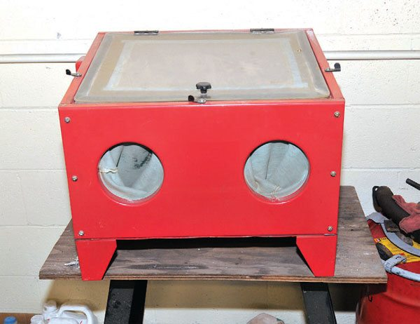 A small media blasting cabinet such as this one is a perfect choice for small parts that have baked-on crust, rust, or paint that resists chemical strippers.
