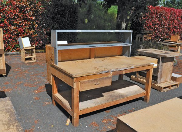 If you keep your eyes peeled, you may find a free workbench like this one. Also, craigslist has an extensive free section.