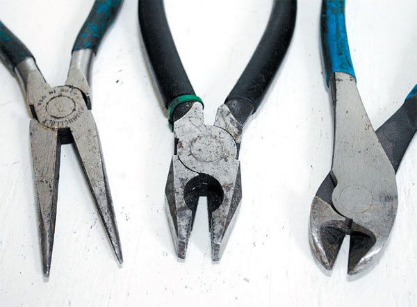 A variety of pliers come in handy for powder coating projects. You need (from left to right): needle-nose pliers, lineman's pliers for heavy work, and diagonal cutters. These are basic tools for any shop.