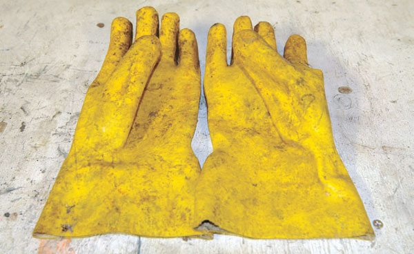 Heavy gloves that are rated for chemicals are good to have around. Nothing eats through them! Often, though, it's a good idea to wear a pair of nitrile gloves under them.