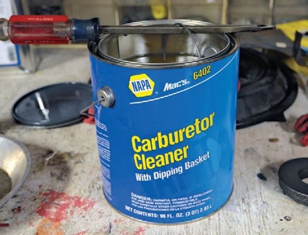 Carburetor cleaner comes in spray cans or in a big can like this. A can comes with a little basket that allows you to submerge parts and easily retrieve them. This is a good product for a long soak to remove old fuel varnish and grunge. It's safe to use on aluminum and pot metal parts.