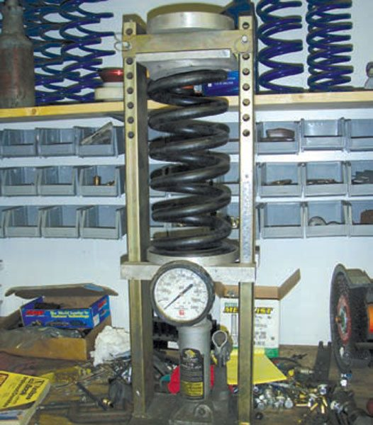 This is the only accurate way to determine spring rate. Calculations get you close, but estimating how much dead coil is on each end of the spring is still imprecise. Note: This spring has a wire diameter as big as a garden hose! Its rate is something over 1,400 lbs/in. (Photo Courtesy Tad Banzuelo)