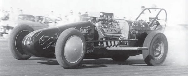 The drag racing scene exploded on the West Coast during the 1950s and quickly spread. By the late 1950s, dragsters were quite common and put on an incredible show for the spectators, while also giving the driver a great thrill. Those tiny slicks didn't stand a chance of hooking up, but that's the way they liked it. (Photo Courtesy Larry Rose Collection)