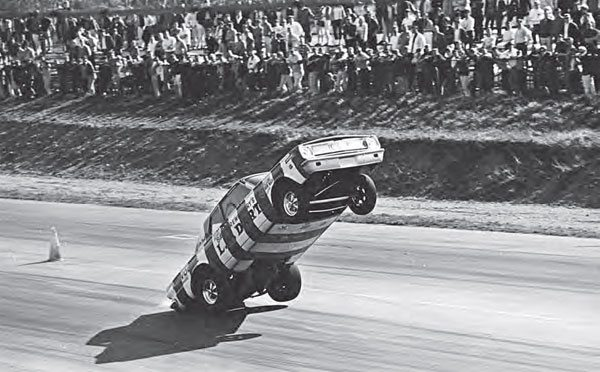 When the big names came to town, Dover Drag Strip filled up with spectators. One such instance was when Bill Shrewsberry's L.A. Dart made its way to Dover. The rear-engine Dart toured the country doing wheelstands for as long as the track allowed. Here, even the rear wheels are airborne, while a huge crowd watches in amazement. (Photo by T. O'Shea, Courtesy www.doverdragstrip.com)