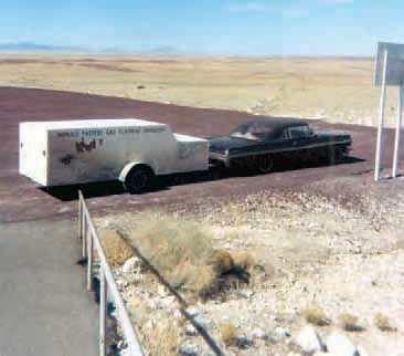 "Ramp trucks were very common forms of transporting drag cars in the 1960s, as were regular passenger cars with custom dragster trailers. It was generally assumed that low-budget racers flat-towed their race cars to the track, while the ""big-money"" teams used car haulers and trailers. (Photo Courtesy Norbert Locke)"
