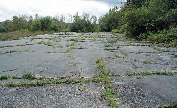 It's a shame that the distinct landscape of Dover Drag Strip has been completely removed with the intense mining. The track had lots of local history, but almost all of it is gone, aside from this wide patch of pavement in what used to be the shutdown area. (Photo Courtesy John Shiner)