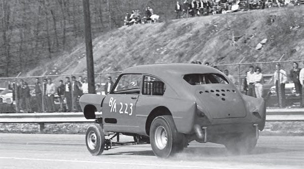 The Northeast had some wild creations in the 1960s, including this Henry J. Running in B/Altered, this car has an extreme amount of engine setback, as you can see by the injector stacks sitting where the driver normally resides. This angle also shows the steep banks and extreme landscape of PID. (Photo Courtesy Bill Truby)