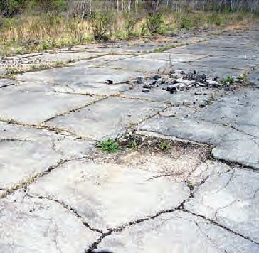 Big cracks and missing chunks of pavement indicate that PID has seen better days. It had a very good surface in its heyday, but the cracks are a reminder that Mother Nature has not been kind to this legendary Pennsylvania drag strip. (Photo Courtesy Bill Truby)
