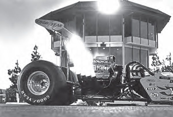 The timing tower at OCIR is one of the most memorable aspects of the high-dollar drag strip, providing a great backdrop for many incredible pictures, such as this nighttime shot of Don Prudhomme. With the candles lit and the tower in the background, the moment is perfectly captured. (Photo Courtesy Don Gillespie Collection)