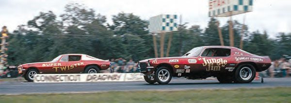 The seldom-seen candy apple red Jungle Jim Camaro appeared at Connecticut Dragway in September 1970 at a huge Funny Car meet. This incredible shot of Jim Liberman battling Joe Petruccelli's Super Twister Camaro includes the unique, checkered boxes, which were a recognizable trait of the track. (Photo Courtesy Bob Snyder)
