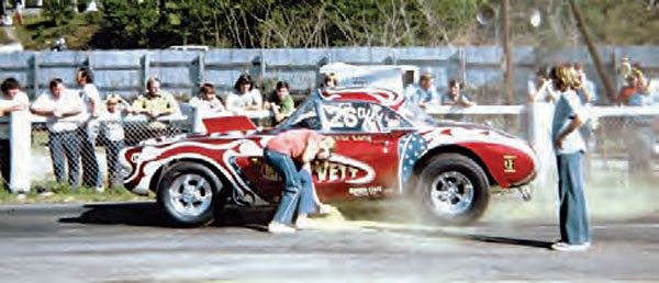 "Traction was hard to find in the old days. Racers often resorted to their own form of traction compound, commonly referred to as ""gold dust."" The racer's crew sprinkled the rosin on the track, making sure the rear tires passed through it during the burn-out. Here, at Drag City in Ringgold, Georgia, some dust is applied. (Photo Courtesy Wayne Holland)"
