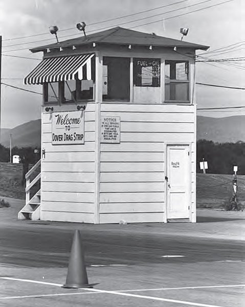 Track photographer T. O'Shea did a magnificent job of documenting the history of Dover Drag Strip with thousands of photos during the track's operation. The timing tower was placed on the pit side (right lane) of the track, and acted as a great backdrop for photos. This is a great shot of the tower in the track's heyday. (Photo by T. O'Shea, Courtesy www. doverdragstrip.com)