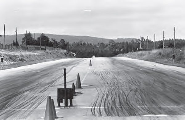 Dover's wide lanes offered plenty of room to reel in a squirrely race car. The track had lots of character, but that didn't equate to very high safety standards. The track managed to land an NHRA sanction, but it only lasted a short while due to the track's lack of safety equipment, such as guardrails. (Photo by T. O'Shea, Courtesy www. doverdragstrip.com)