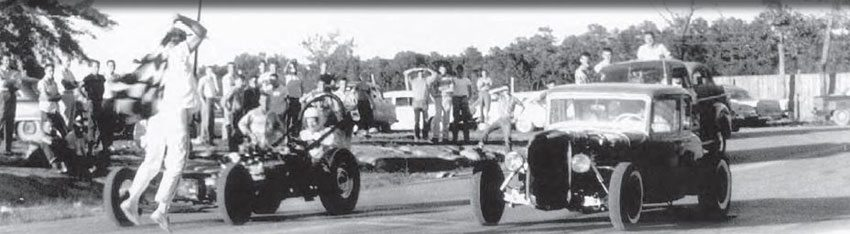 When the Brainerd Optimist Club Drag Strip opened, the races were held north of Chattanooga, in the small town of Hixson. Complaining neighbors forced the club to move its operations to a new facility in 1964. Here, a heavily channeled 1932 Ford coupe lines up against a home-built dragster as the flagman gives them the signal. (Photo Courtesy Larry Rose Collection)