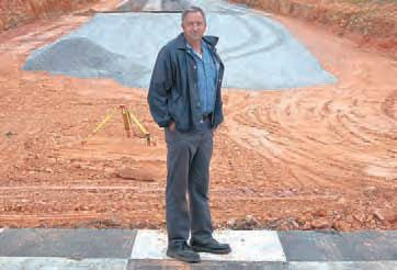 Mount Olive, Alabama, resident and long-time racer Randall Shew played a big part in the revival of Lassiter Mountain Dragway. Here, he stands in front of the track, which underwent a major renovation prior to its grand re-opening in 2010. Track owners Jay Bostic and Donald Phillips made great improvements to the facility. (Photo Courtesy The North Jefferson News)