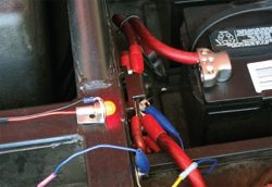 For this example, I rigged up a small light. Note the connections via the blue alligator lead to both the main circuit breaker and the chassis.