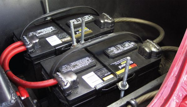 Wiring a pair of batteries in parallel is a snap. Just connect the pluses (positive terminals) together and the minuses (negative terminals) together. As shown in the Olds, those connections are done via 1/0 AWG wiring and aftermarket battery clamps.