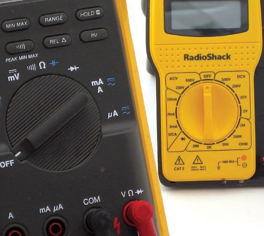 The inexpensive Radio Shack DMM combines the range and selector switch into a single control. This makes the meter far less versatile than the Fluke 87, but it can be owned for a fraction of the price.