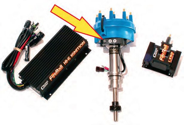A high-output ignition system is paramount for achieving good fuel mileage, as are the programmable advance curves of this Crane ignition system. The most important aspect, however, is the vacuum-advance system (arrow).