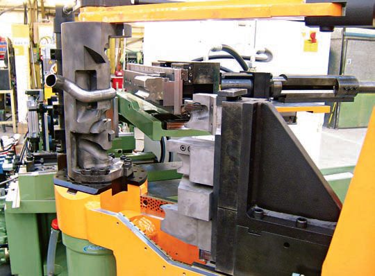 Here, custom application-specific dies are being used on a CNC bender. (Photo Courtesy Addison-McKee)