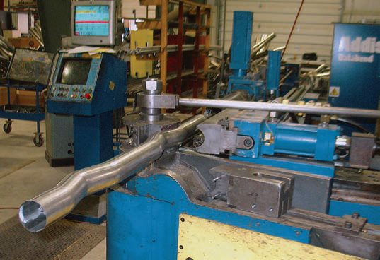 The CNC bender feeds the pipe through the dies, automatically rotating the pipe for multiple bends according to the software program.