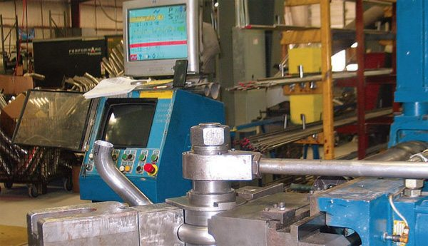 Each individual primary tube for a specific header requires its own bending program. Once a length of straight pipe of the appropriate diameter is inserted into the machine, the CNC bender completes all of the bends required for that section of tubing, while the CNC technician monitors the process.