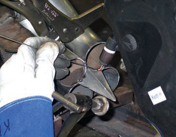 Here a merge spike is tack-welded to the primary tube ends. The spike is first positioned on a centering jig for precise centering and orientation.