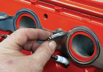 Where practical (in terms of installation clearance), the use of exhaust studs is a great idea. Studs provide a convenient guide for header positioning. In addition, for situations where the headers are removed and installed frequently (as with race cars), the use of studs eliminates thread wear that is possible with continued removal/ installation of bolts. Install studs finger-tight, with a slight preload. Never double-nut a stud and attempt to overtighten it. The clamping force of the nut secures the flange.
