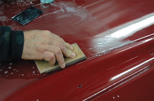 Never color sand directly on an edge, corner, or any raised/peaked surface. Sand up to it, as shown here and in the prior photo. If you sand on it, you will immediately go through the clear coat, if not through the paint—guaranteed.