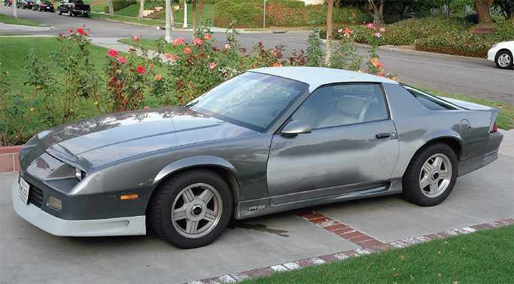 Steve Dalton's neighbor had this slightly scruffy '91 Camaro and it quit running. A fuel-injected car, he figured it would cost too much to fix, so he was going to sell it to the local Pick-A-Part wrecking yard for $200. Steve offered him $200 for it, ascertained it was a bad fuel pump in the tank, replaced it, and had the car running fine in a few days. It had alloy wheels, a decent interior, and other amenities, but the body had some scrapes and dings (and prior work) and the paint was sad. So Steve started doing some bodywork on it and planned to take it to a one-day type shop for a repaint in the original color.
