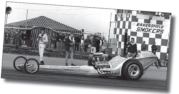 """The freshly painted AA/FD Bushwacker madean early appearance at the Smokers meet inBakersfi eld. Lyle Kelly held the reins and pulledwrenches for Don Tognotti. Don Garlits lookedat it and said, """"You guys might have somethinghere."""" Not long after, he started to play withstreamlining. Note the zoomie headers ratherthan the earlier weed burners. (Photo CourtesyJames Handy/jameshandyphotography.com)"""