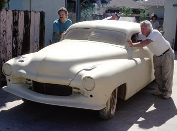 "That's when Hershel "" Junior"" Conway, who began his illustrious painting career at George Barris' shop as a teen, volunteered to paint the car, in original lacquers, in his shop in the short time available. With Junior steering and Jim helping, this is how the car looked as it left Jim's driveway."