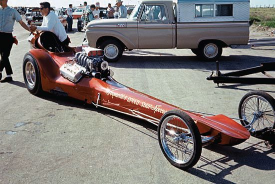 Bushwacker debuted in 1964 at the Oakland Auto Show under the name Goldfinger. It featured a subdued copper paint and additional tinwork that was later reworked. It took a while to work the bugs out of the Ron Welty hemi; initial outings produced bottom-8-second times at 196-mph times. The engine featured fabricated headers, GMC 6-71 blower, Joe Hunt magneto, Engle 440-5 roller cam, Donovan rocker assembly, four-bolt main caps for added bottom-end strength, and O-ringed block to help with the seal. This photo was shot at the 1965 March Meet at Bakersfield. (Photo Courtesy James Handy)