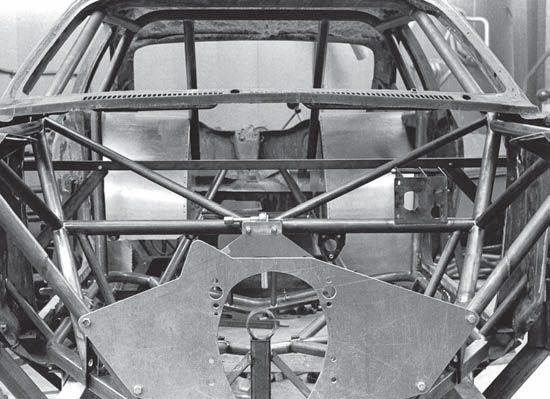 A head-on shot of the nearly complete chassis reveals the fabricated motor plate, underdash cross bracing, and wheel tubs. Motor plates were fabricated for both small- and big-block engines, even though a big-block was never installed.
