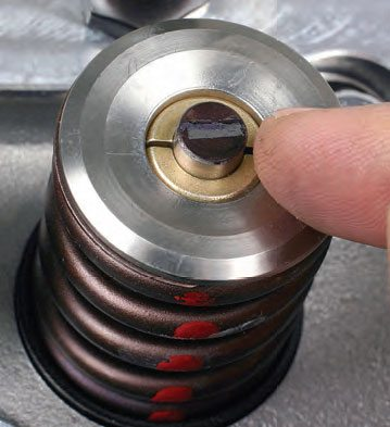 With pushrods and rockers installed, hand-rotate the crank through two full revolutions, then remove the rocker.