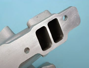 Depending on engine design/type, the manifold may have port pairs that are placed very close together. When port matching, align these divider walls to the heads first, and be careful not to eliminate the gasket sealing area.