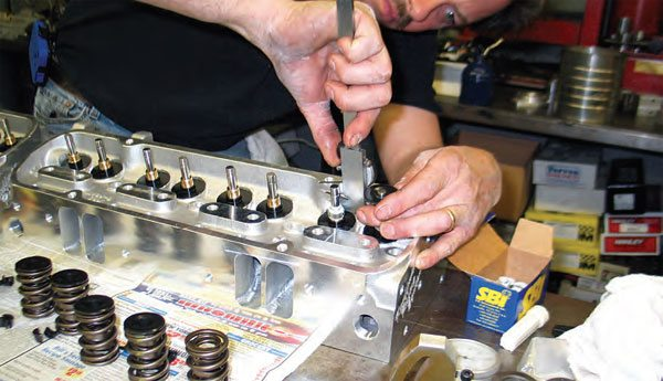 Measure the distance between the top of the valveguide seals to the valve locking grooves as a reference prior to installing the springs. This helps when checking retainer-to-seal clearance at full-lift/valve open.