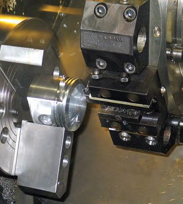 Once the program has been written, an entire set of pistons can be cut on a CNC lathe in a matter of a few minutes.