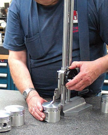 Once pistons have been machined on the CNC lathe, dome height is verified.