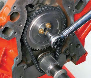 In order to degree the cam, install the timing setup. With number-1 piston at TDC, align the timing marks on the crank and cam gears according to the OEM locations (usually the cam gear dot is at 6 o'clock and the crank gear is at 12 o'clock, but this can vary depending on engine design). Snug the cam gear bolts. Just remember to apply thread locker and to torque these bolts to spec once you've set your cam timing.