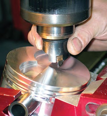 A milling bit adjusted to the proper valve head diameter (with proper clearance added) is used to mill the valve reliefs.