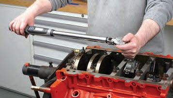 If the rod bolt-tightening specifications call for a torque-plus-angle (typical for many of today's OEM rod bolts), a digital torque/ angle wrench makes the job easy. Press a button, set the torque, and tighten until the wrench beeps. Push another button to set the required angle, and tighten again until the wrench beeps. Shown here is rod bolt tightening (with new OEM rod bolts), on a GM LS engine, using a Snap-On digital torque/angle wrench.