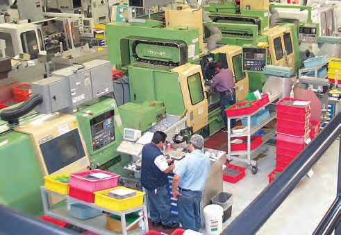 Manufacturers commonly utilize CNC machining for speed of product output and precision results. This shot shows a few of the production CNC machining centers in JE Pistons' facility.