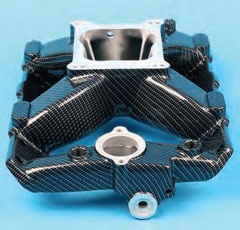 Hydrographics (wet ink film graphics) provides a simple and relatively inexpensive way to create a unique visual impact. This manifold was ground smooth, polished, then delivered to a dipping service. The techs at Dip 'N Designs (Wooster, Ohio) applied a black basecoat, carefully dipped the manifold through a water surface suspended with carbon-fiber ink film, rinsed, dried, and then clear coated the manifold. Since the graphic ink film is somewhat translucent, the black base coat was needed to achieve the desired hue.