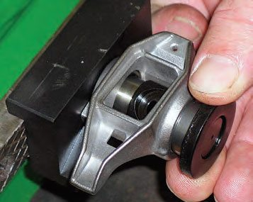 Place one of the kit's washers over the exposed end of the trunnion, against the outer face of the new bearing.