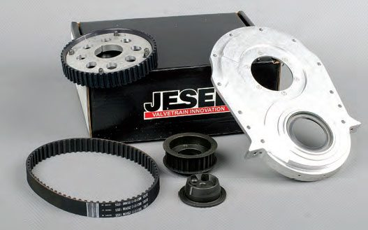 An example of a belt drive; this one is a Jesel for big-block Chevy. The kit includes the backing plate, cam hub, bronze thrust washers, crank gear, and belt. The backing plate covers the front of the engine, sealing it off; the cam hub allows the cam gear to be mounted on the forward side of the cover. Cam timing adjustability via a two-piece cam gear offers +8/–8 degrees of change.