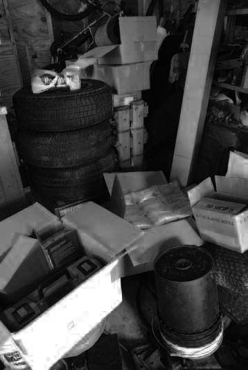 Here's why you should stay organized: In this picture of my garage, the car's bucket seats are toward the back of the garage, behind the stack of tires, behind the boxes of new parts, and behind the mounds of old parts. Moving everything out of the way will take at least half an hour, whereas if everything were rationally organized or stored out of the way, getting to the seats wouldn't take any time at all.