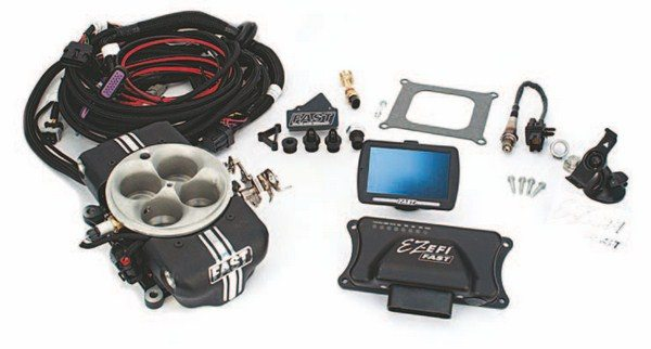 Fig. 2.1. The FAST EZ-EFI 2.0 system is the company's latest offering at the time of this writing. The 4150 throttle body has eight injectors and supports up to 1,200 hp. The base system includes all of the components shown here, including the color touch screen handheld/dash-mount controller. This system performs fuel metering and offers electronic timing control when you add the company's EFI-style distributor and crank trigger. (Photo Courtesy FAST)